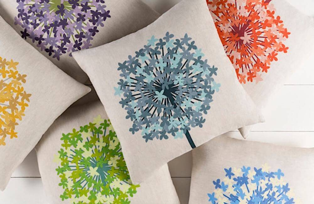 Pillows, chairs, wallpaper and more–all spot on with the floral interior design trend.