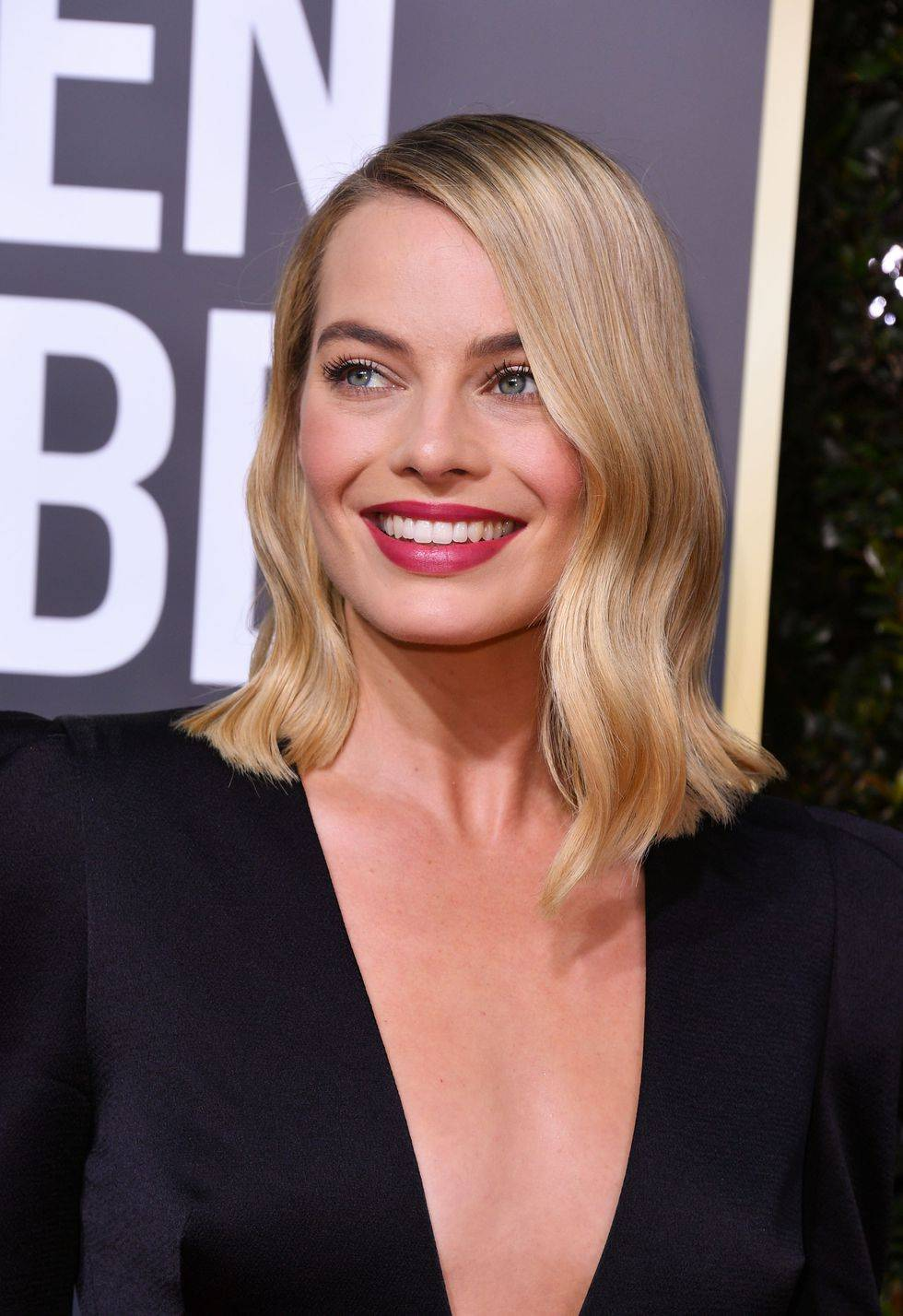 Margot Robbie with curly hair