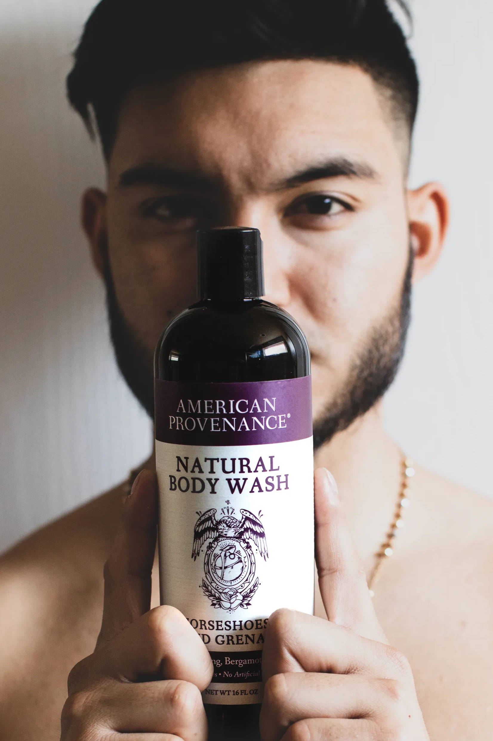man holding body wash