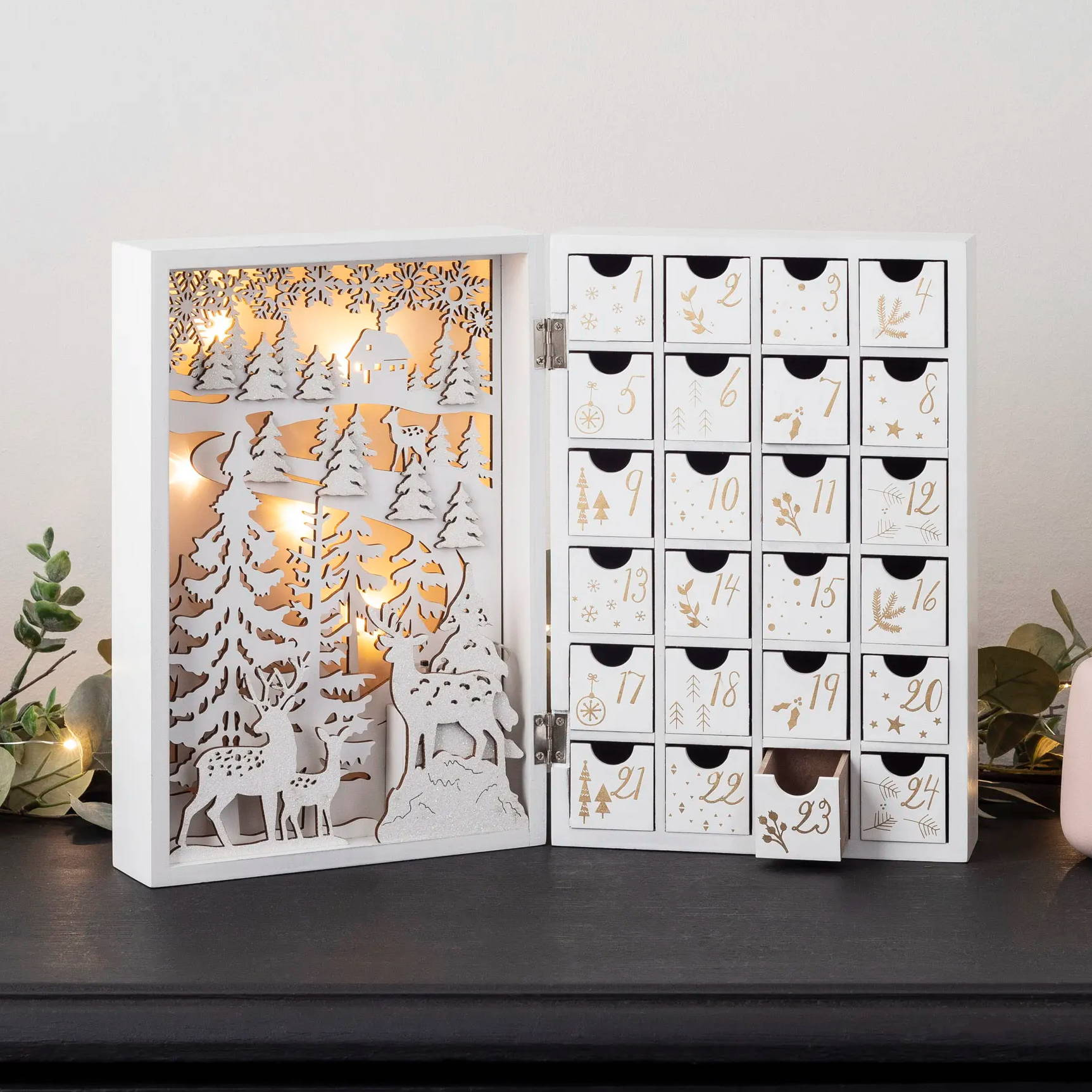 winter scene inside a wooden light up advent calendar
