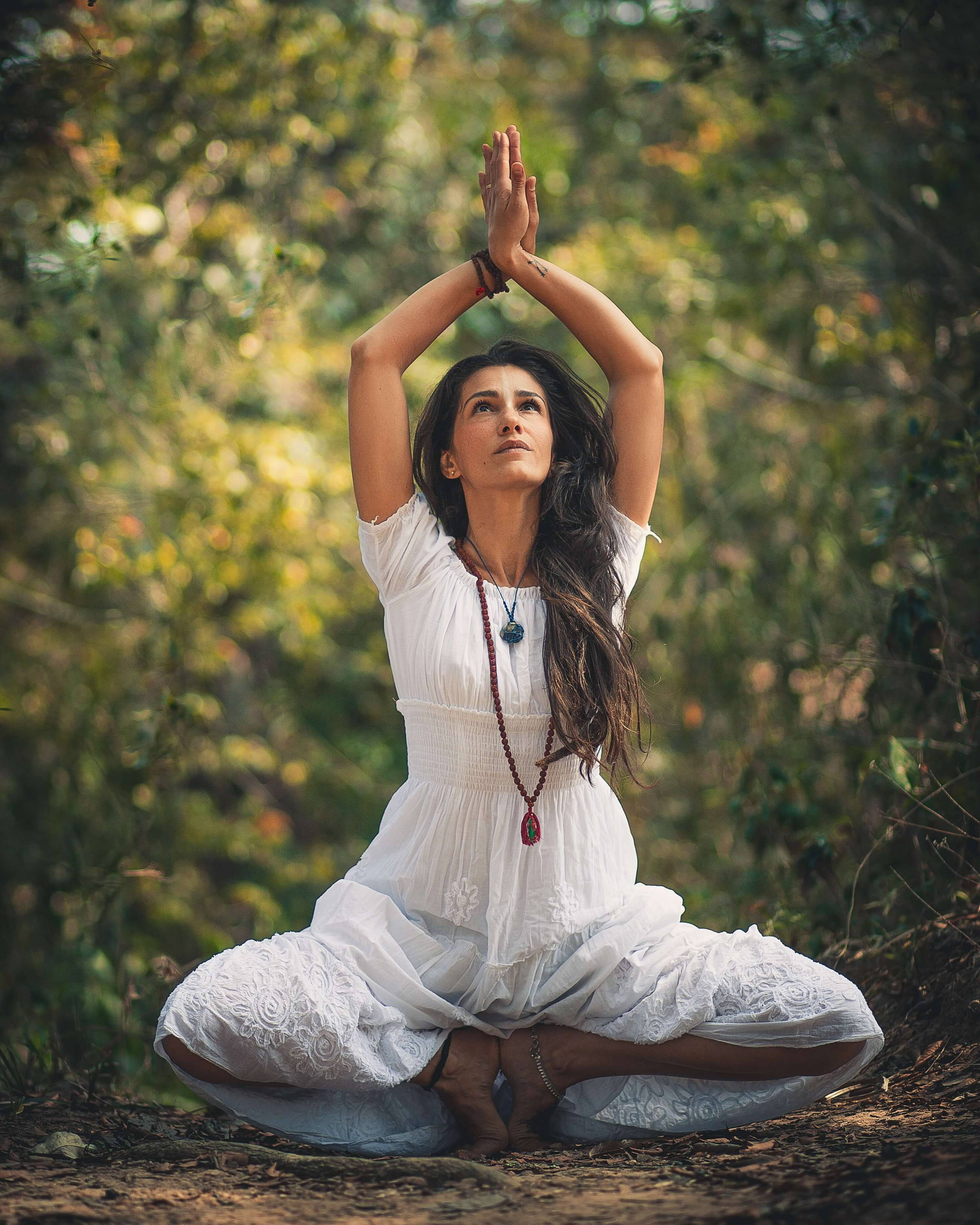 woman doing yoga with nature
