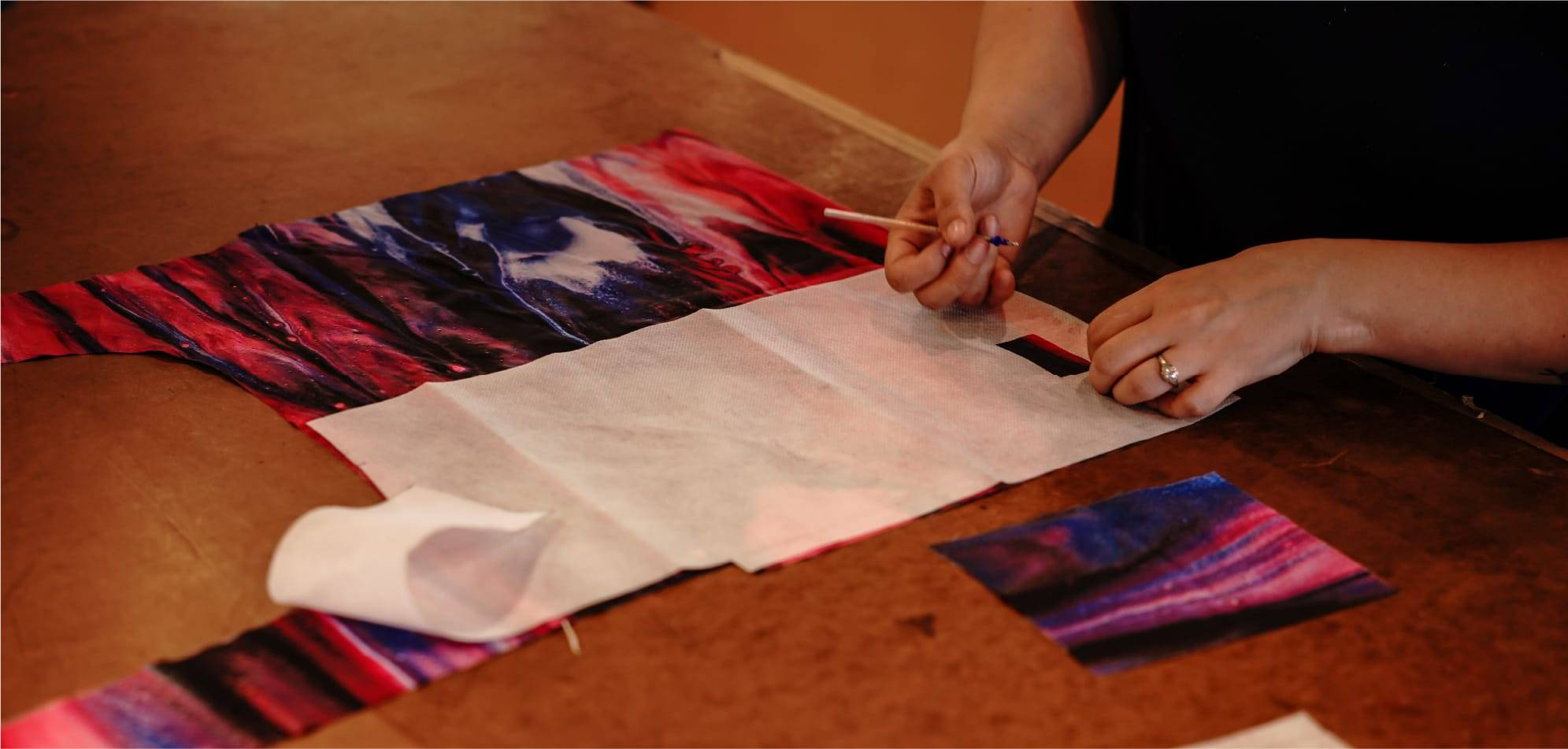 Woman cutting out the pattern of a reusable tote