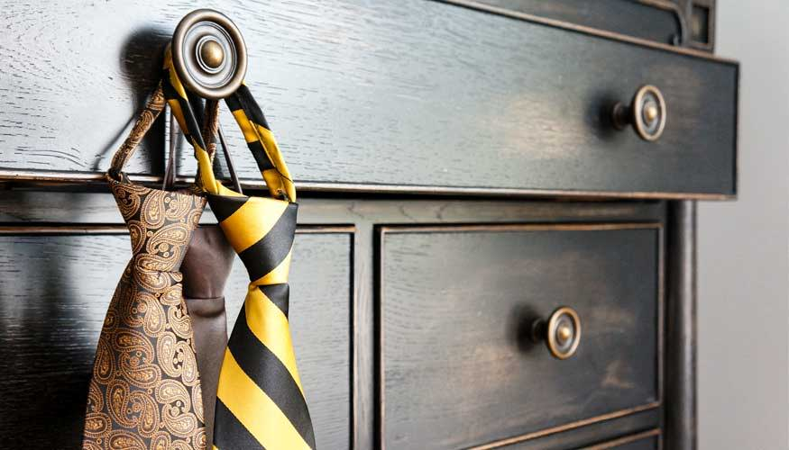 Pre-tied zipper ties hanging from a dresser