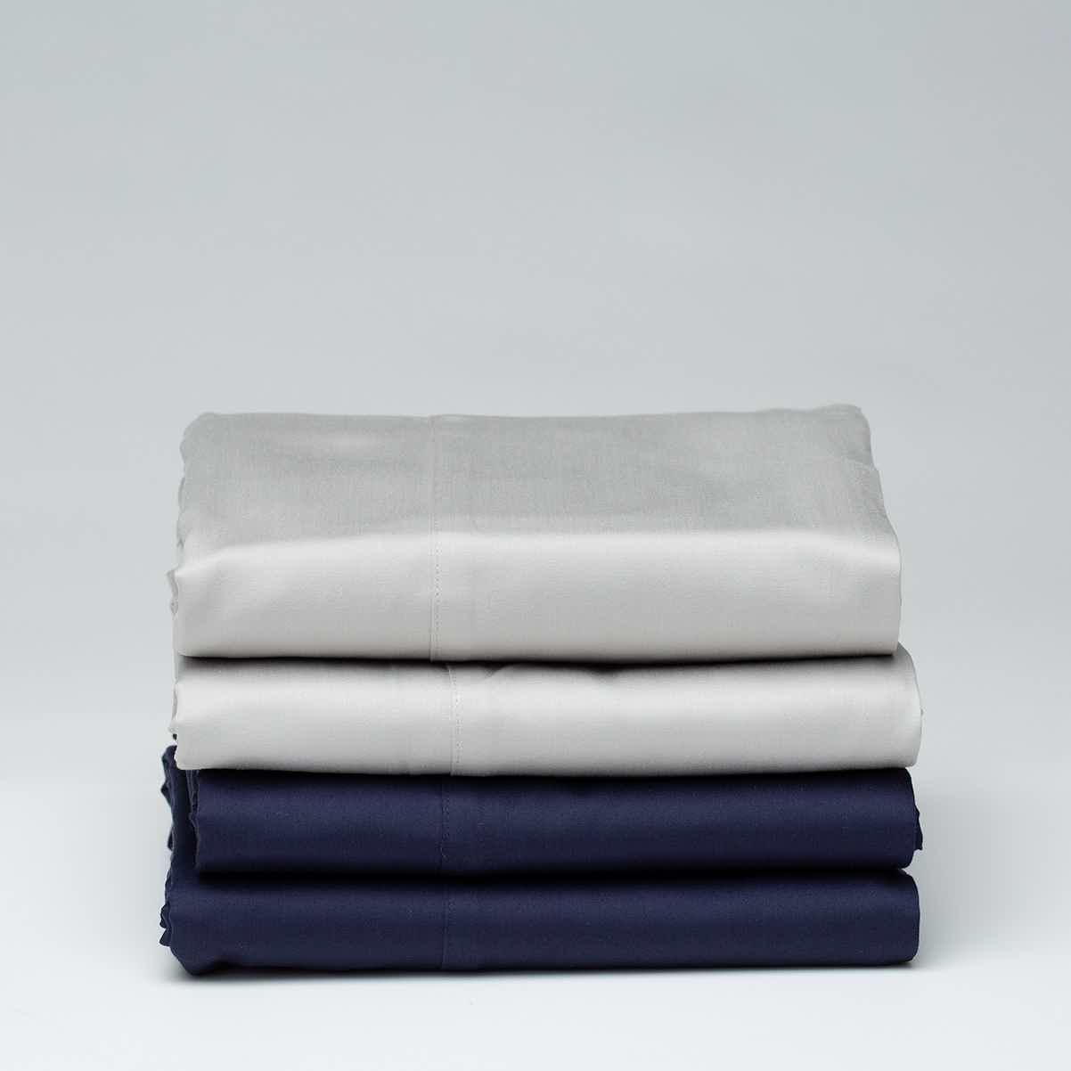 light gray and navy folded organic sheets