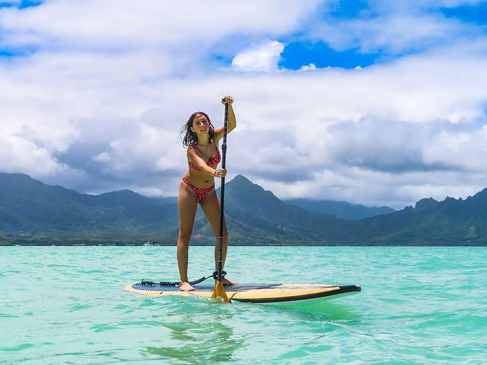 girl paddling the big ez hawaiian vft paddleboard