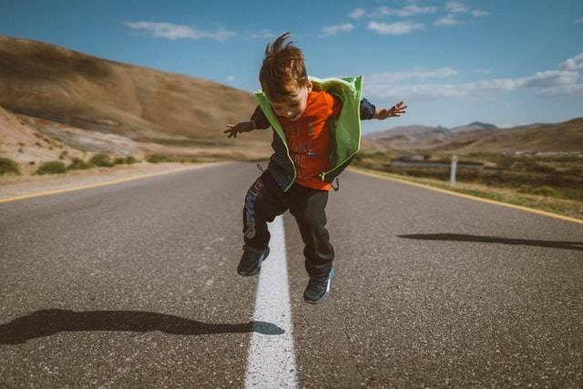 Kid Jumping On Road