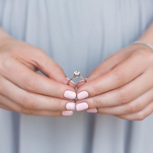 diamond ring held in hands