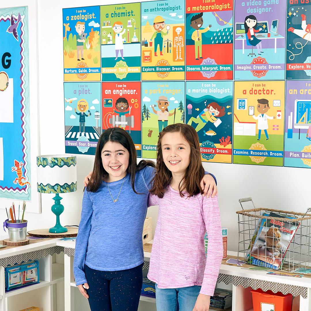 Girls in front of STEM Bulletin Board