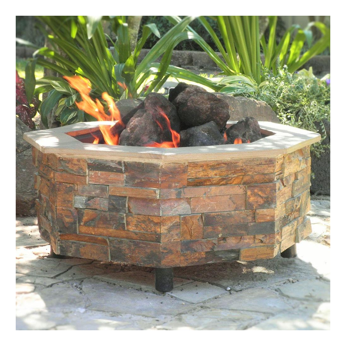 A stone DIY fire pit finished and filled with lava rocks