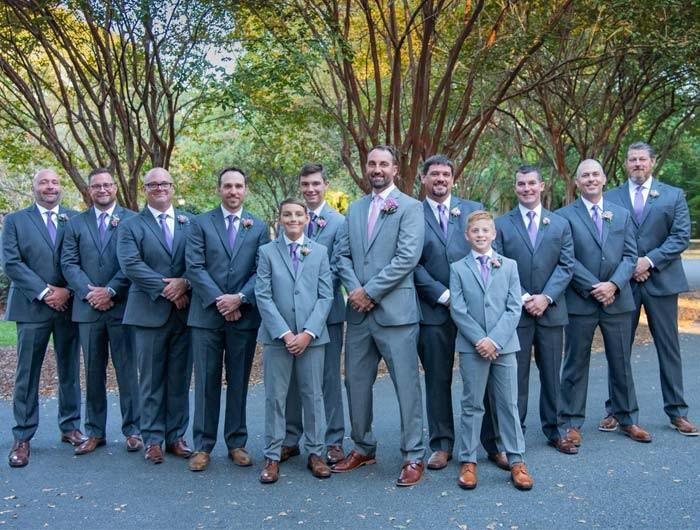 Wedding party group with the guys, groom, groomsmen and junior groomsmen