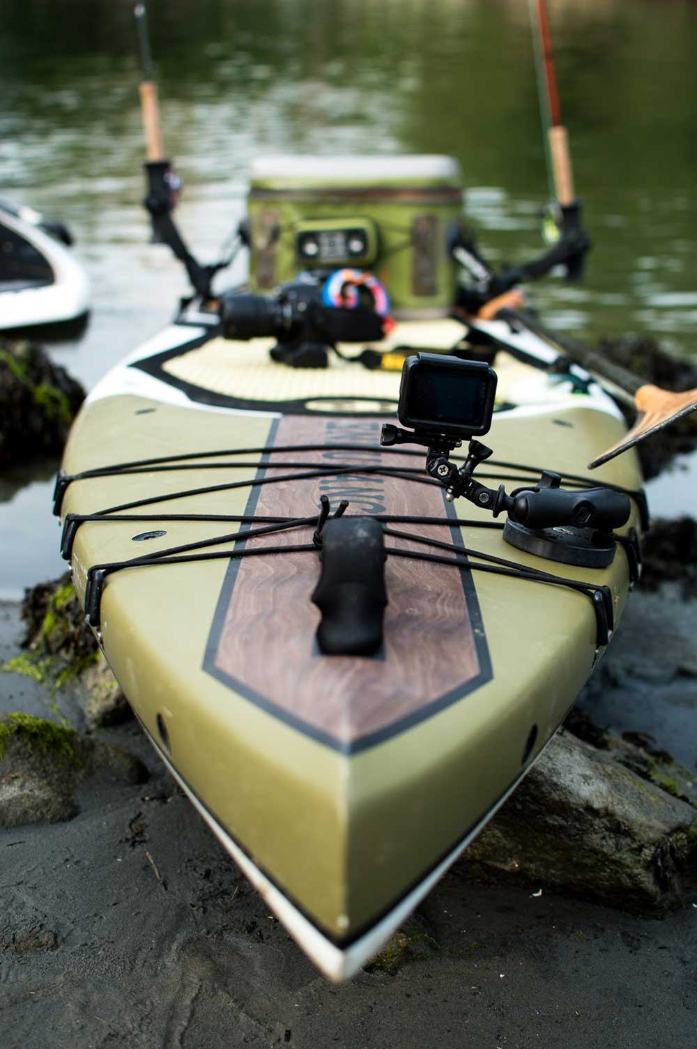a paddleboard loaded with accessories