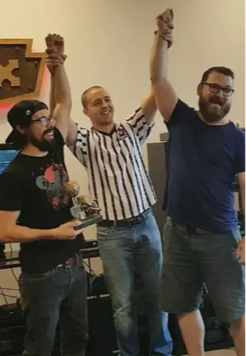 Photo of J!NX employees winning a video game tournament