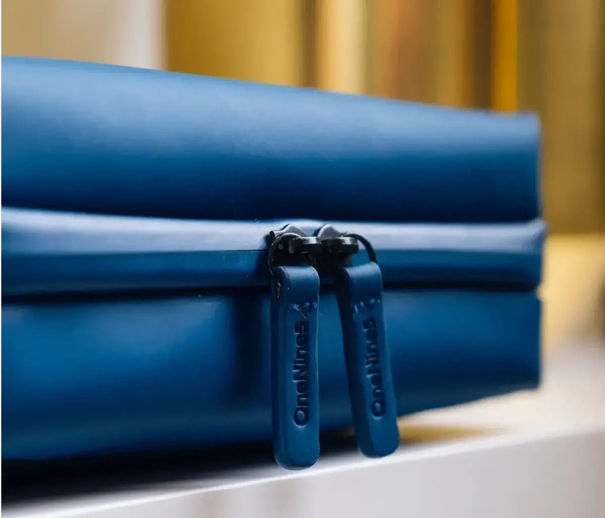 A close-up of a OneNine5 Havelock Blue, eco-conscious toiletry bag