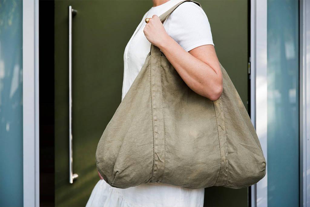 Model holds the Frankie Bag over one shoulder