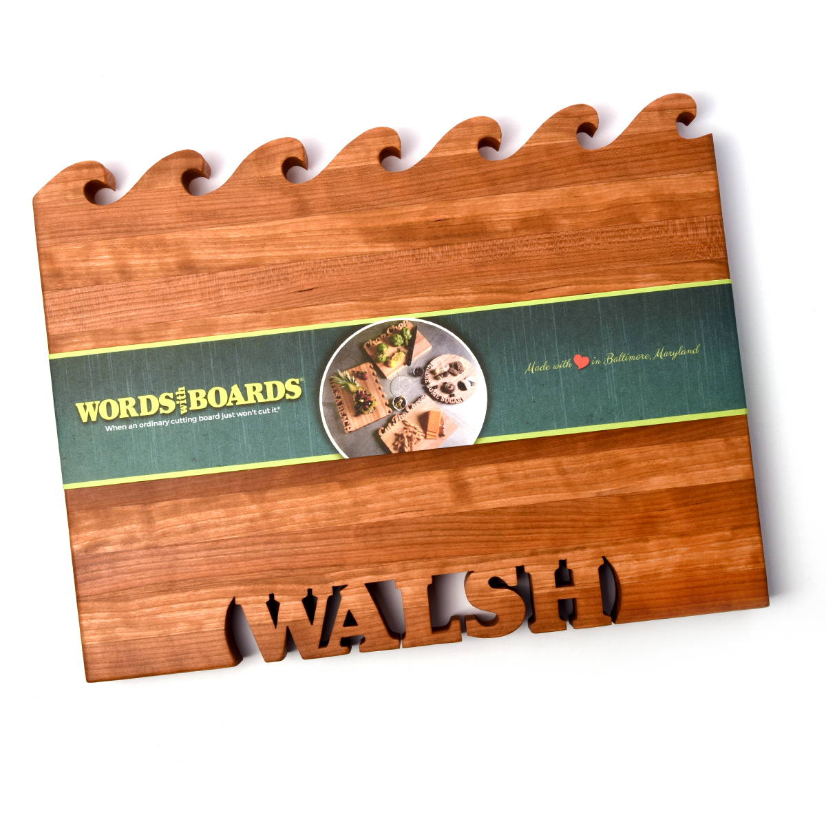 Cherry wood cutting board with waves cut out and last name cut out