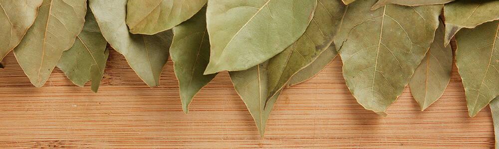 High Quality Organics Express Bay Leaf over Wooden Board