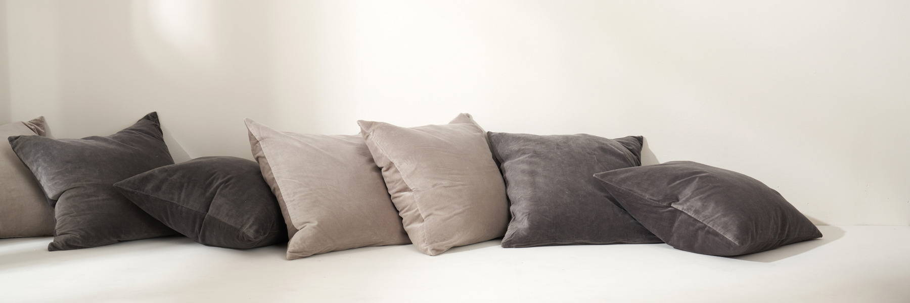 Truly Lifestyle Living Banner With Grey And Charcoal Cushions