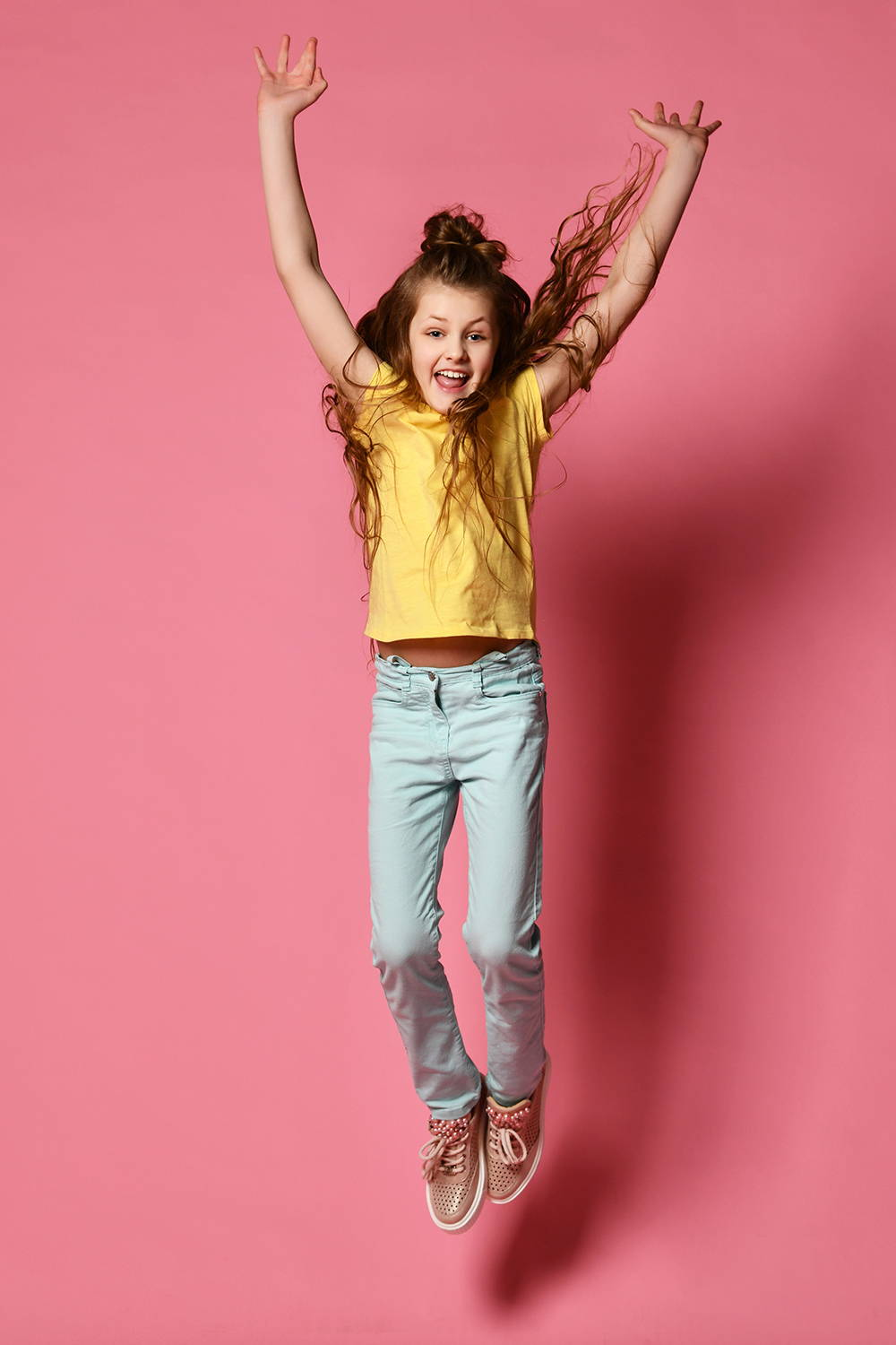 Girl Wearing Jeans Jumping Up
