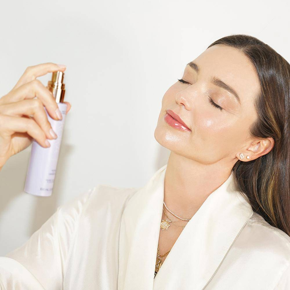 Picture of Miradan Kerr spraying the Calming Lavender Mist on her face