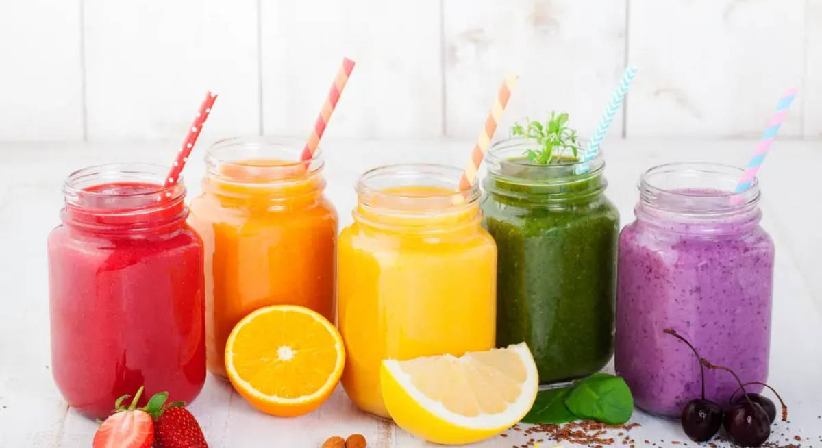 different fruit and vegetable juices in glass mason jars|top ten summer juicing recipes