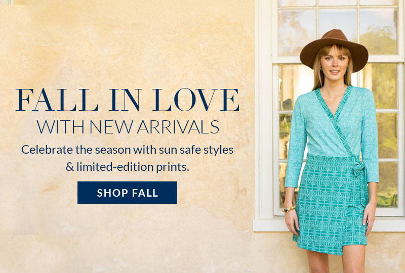 Fall in love with new arrivals. Shop Fall Collection. Woman wearing Buckhead Wrap Dress with brown hat.
