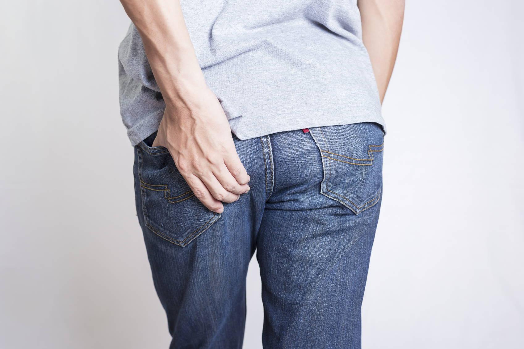 man holding his butt sciatica