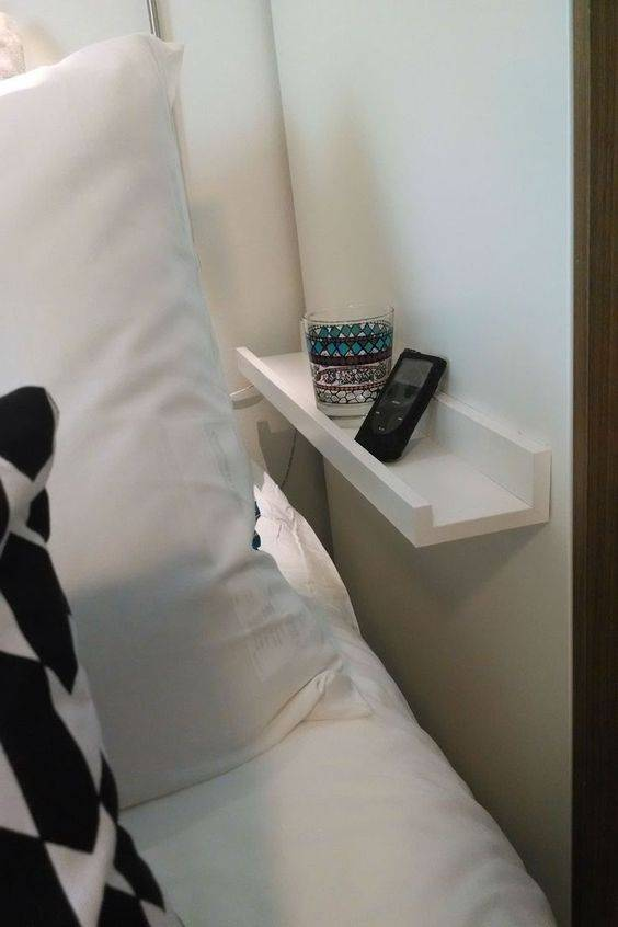 Picture ledge as bedside shelf