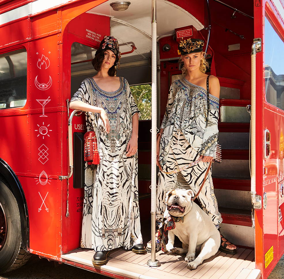 Models in bus wearing CAMILLA black and white kaftan, tee and pants