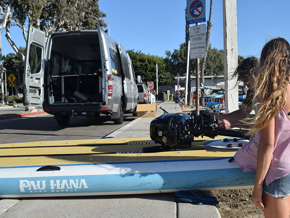 Loading the motor onto the pau Hana Bimini SUP