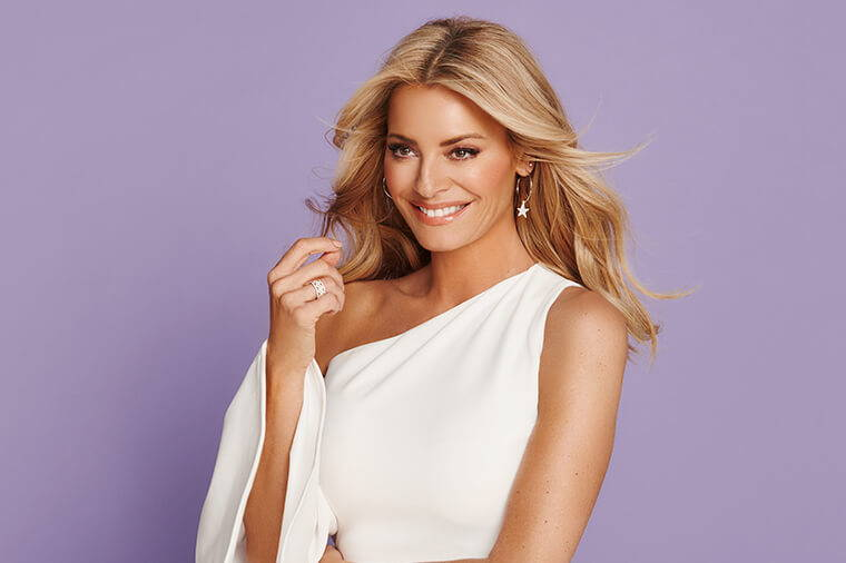 Tess Daly With Purple And Gold Backdrop
