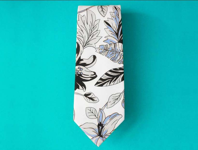 Men's floral hawaiian style tie on a turquoise plain background