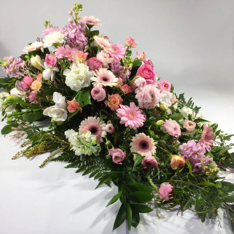 Pink flowers on a funeral casket
