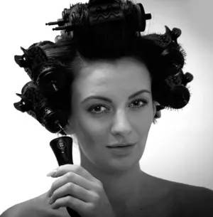 Girl with curlers in hair