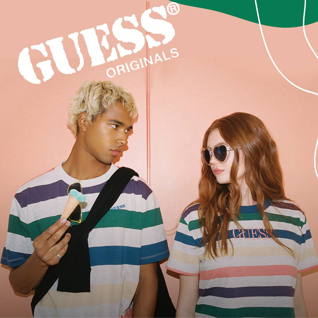 a cropped image of a man and a woman wearing guess orignals clothing