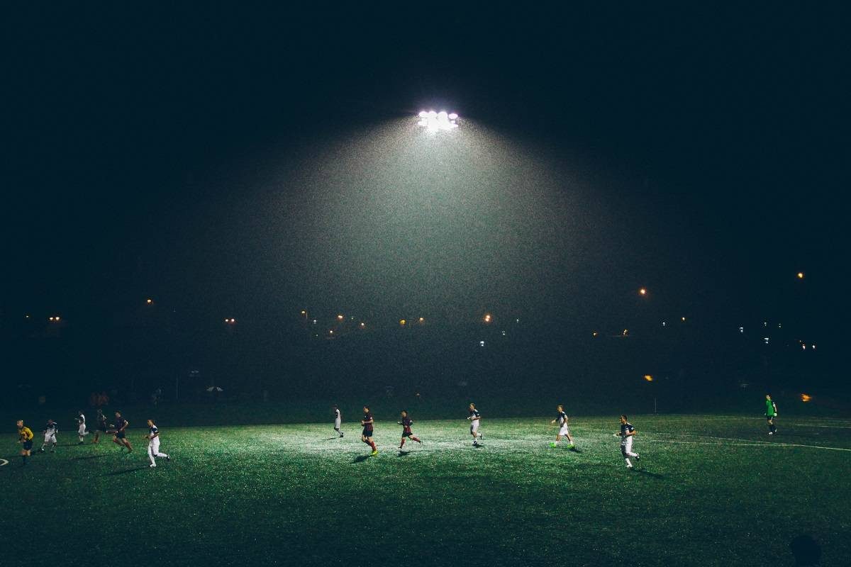 Flood lit football match on synthetic pitch