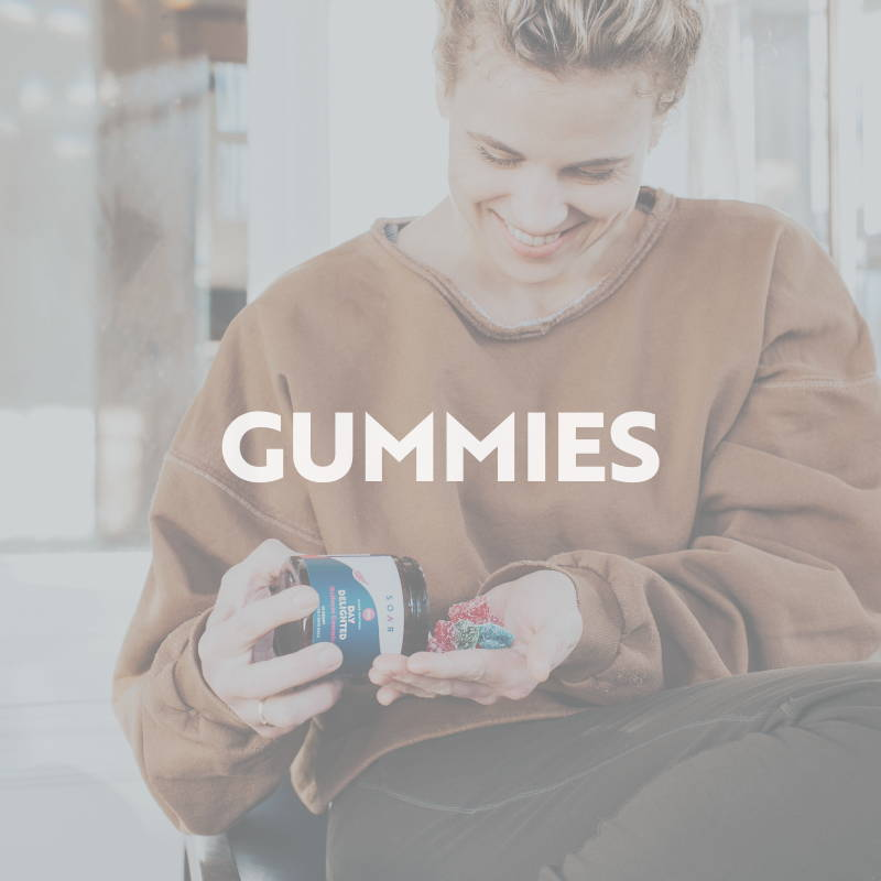 Person holding SOAR™ CBD hemp gummies