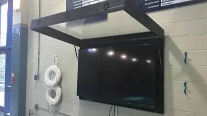 Open outdoor TV cabinet with lid and gas shocks The TV Shield Pro in pool house