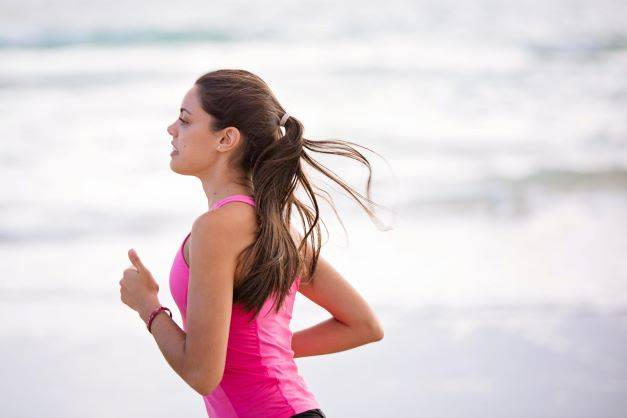 Woman In Pink Top Running