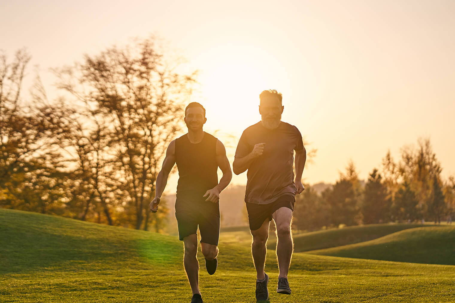 Two Men Running In A Park