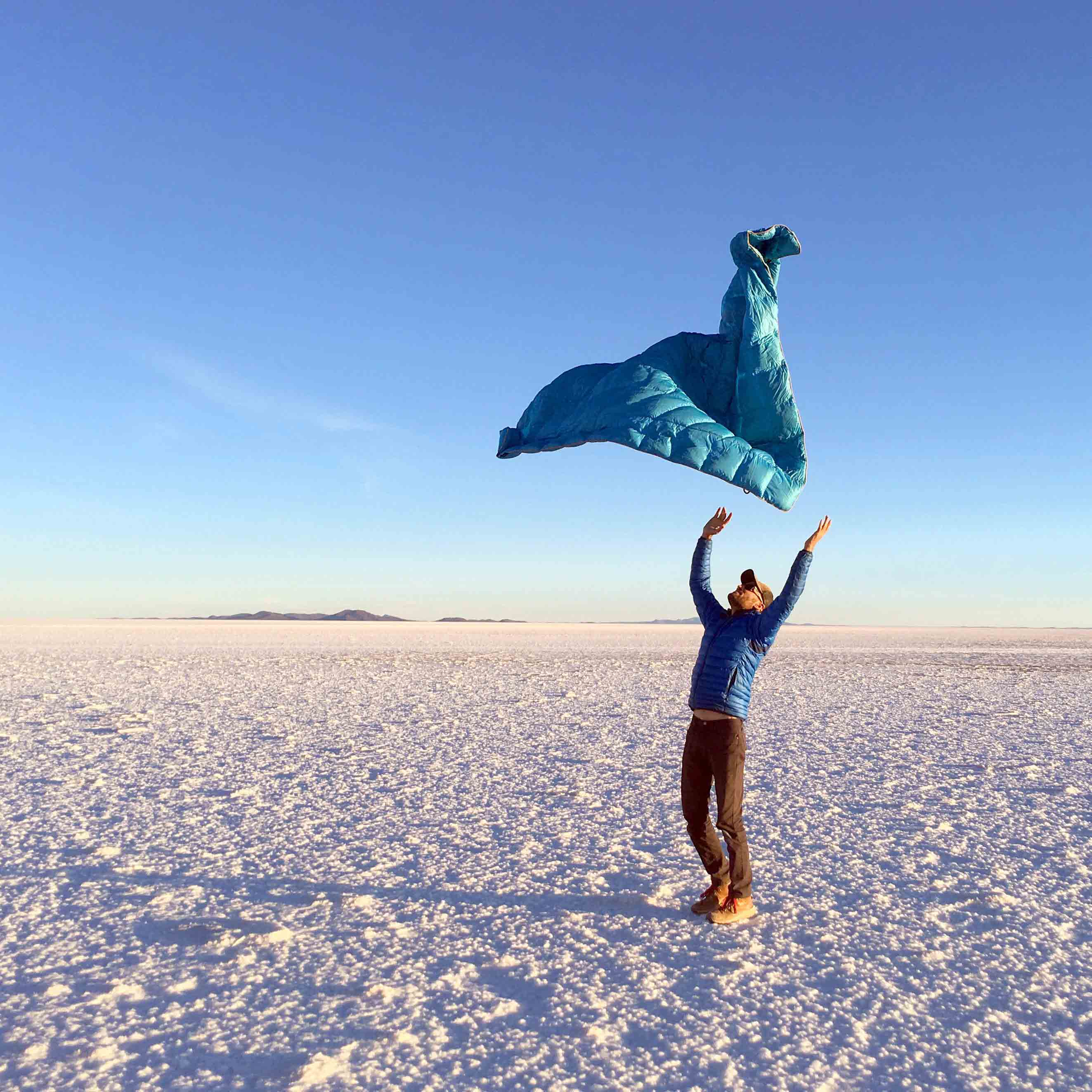 Throwing blanket into the air in the salt flats
