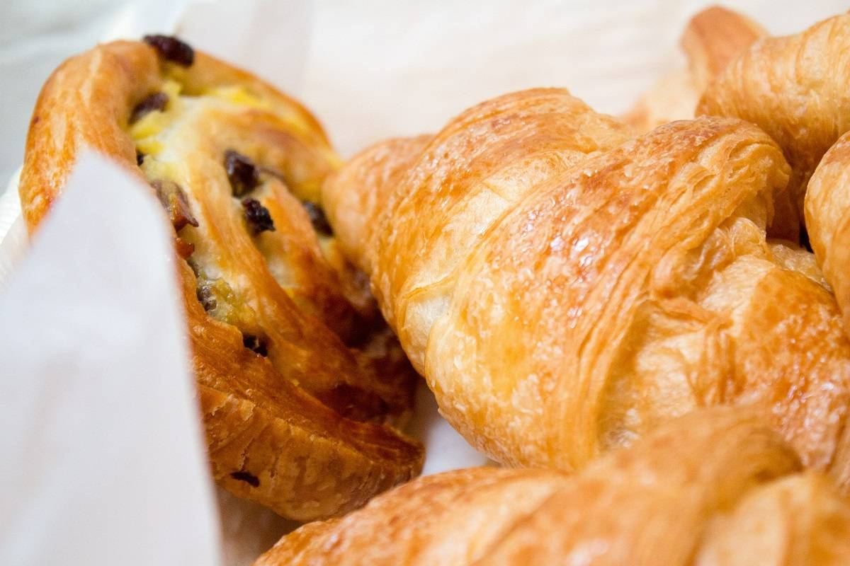 A selection of French pastries including croissants and pain aux raisin