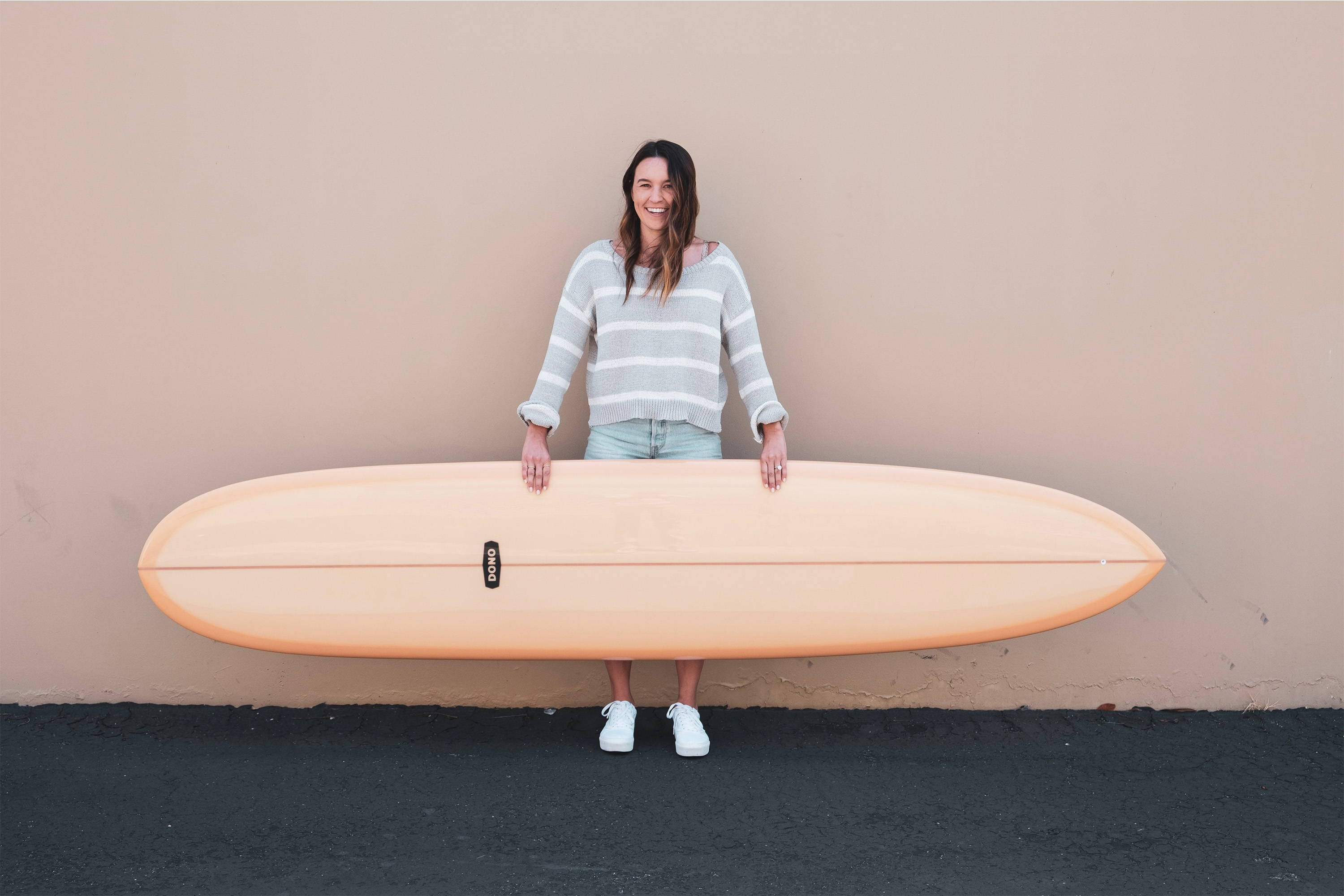 Surfer Girl Holding New Longboard Surfboard