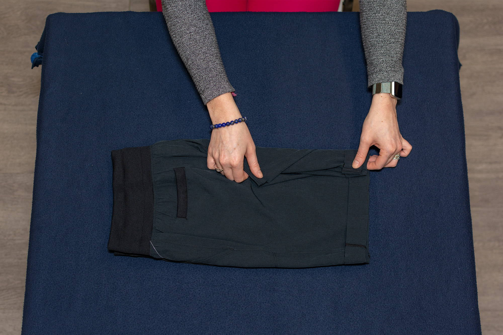 hands folding long shorts