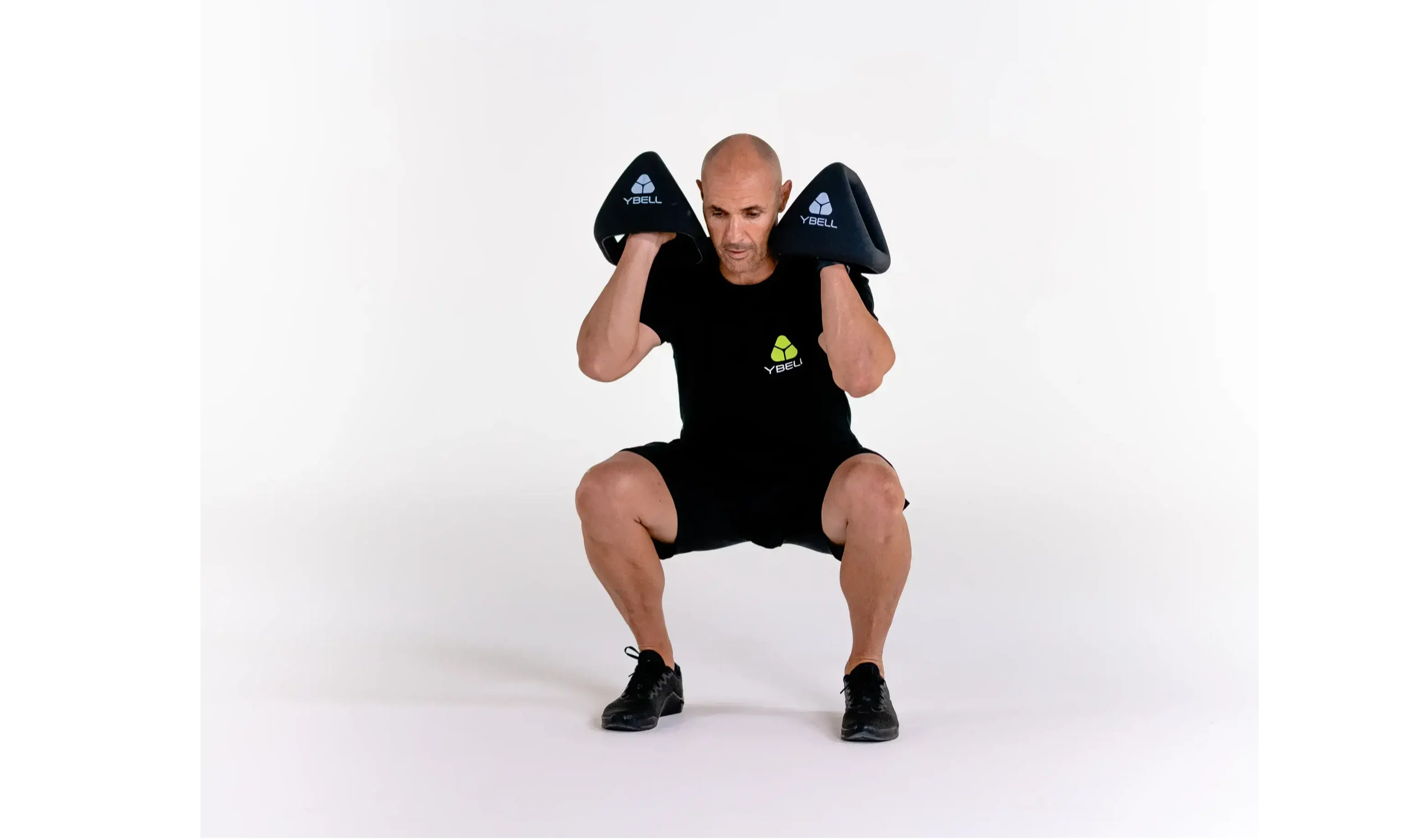 Aaron Lawrence demonstrates a dumbbell squat press with a set of YBells