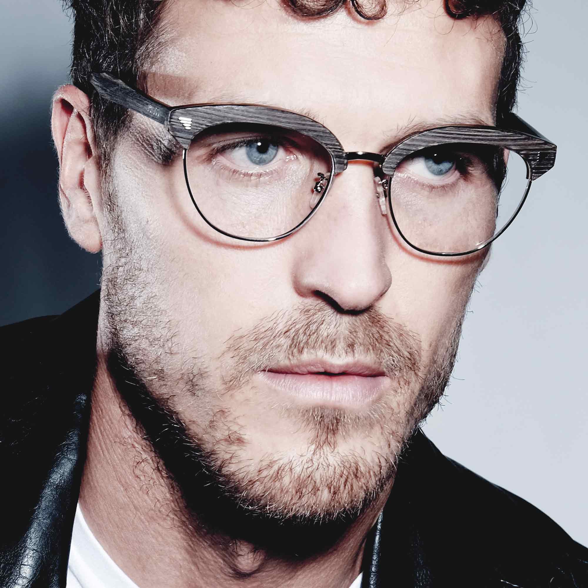 Male model wearing joiuss malcom dark wood glasses