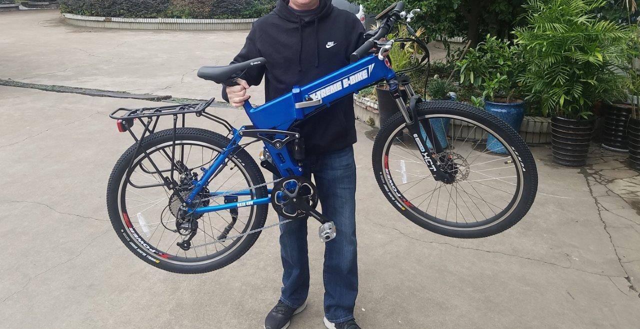 Baja electric bike being lifted