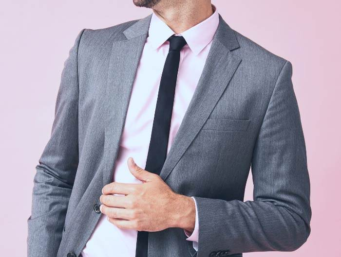 Man wearing a black skinny tie with a gray suit