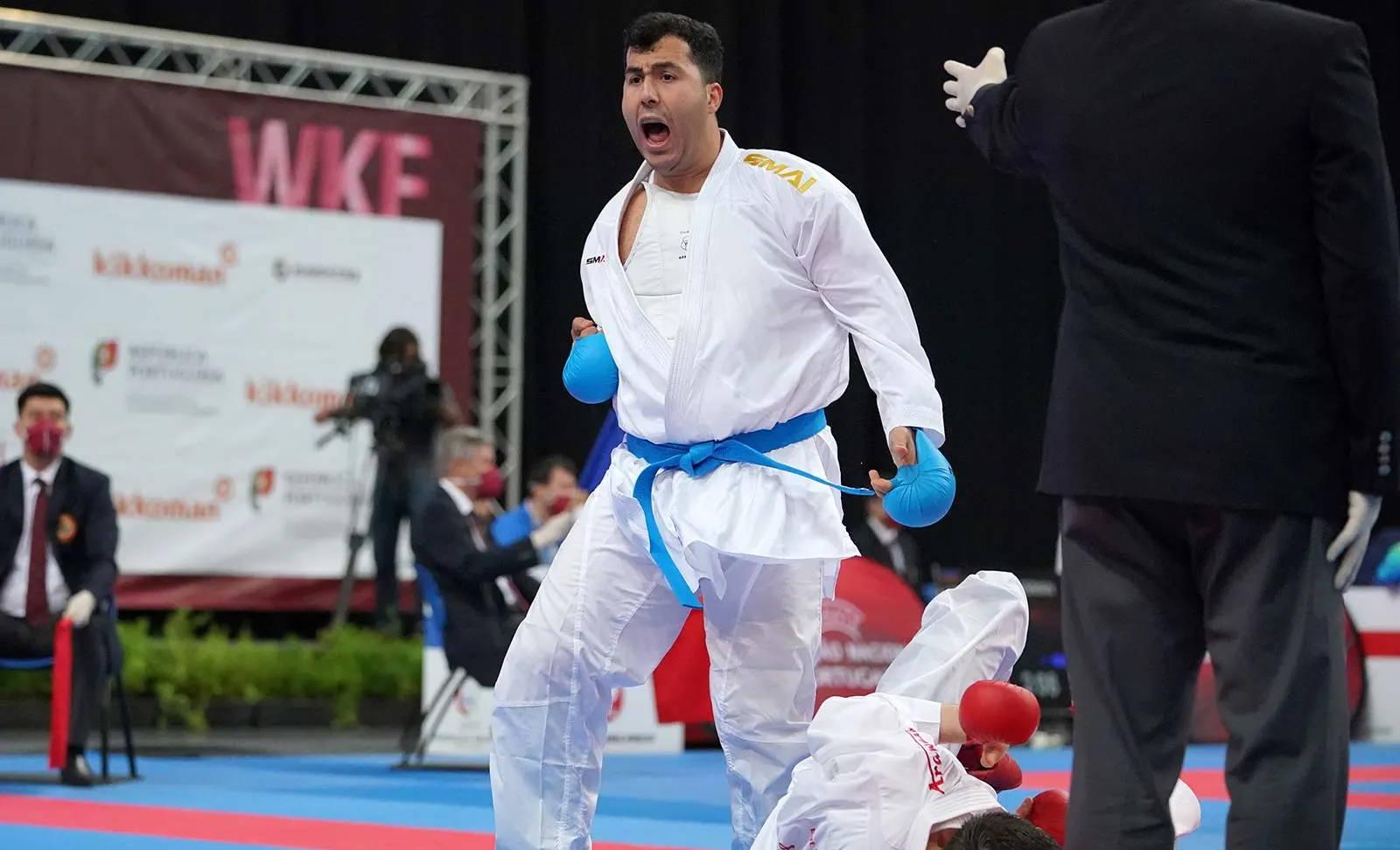 olympic karate athlete Sajad Ganjzadehcelebrates victory