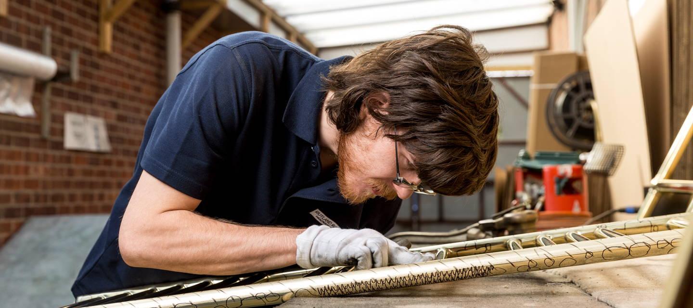Rutland Radiators Inspecting Heated Towel Rail