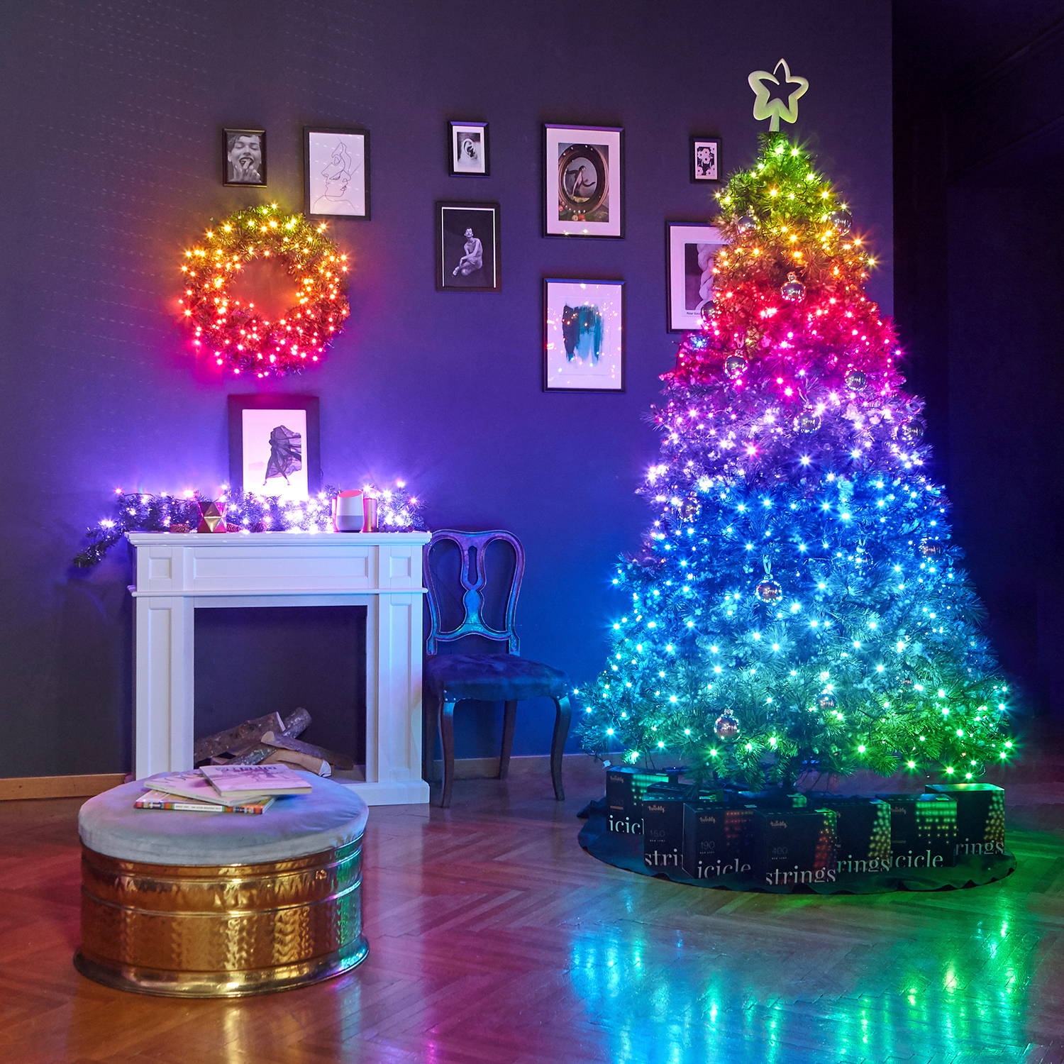 Multi coloured Twinkly lights adorning Christmas tree, wreath and garland in living room